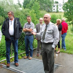 Mr. Ing. Dieter Stadlbauer explains the functioning of a flood protection plant which was visited during an inspection.